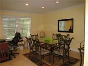 DINING AREA/ WITH ROOM FOR COMPUTER DESK - Condo for sale at 1087 W Peppertree Dr #221d, Sarasota, FL 34242 - MLS Number is A4493593