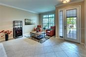Grand Entrance Showcasing Cozy Living Room - Single Family Home for sale at 7739 Us Open Loop, Lakewood Ranch, FL 34202 - MLS Number is A4494156