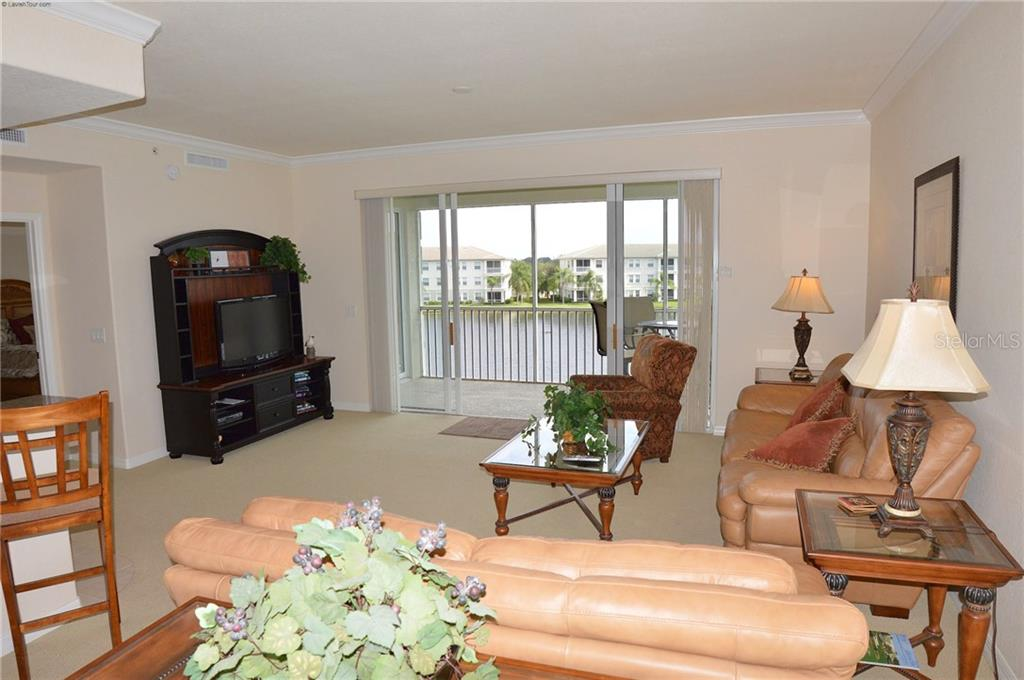 Living Room to Lanai - Condo for sale at 1100 San Lino Cir #1134, Venice, FL 34292 - MLS Number is N5910364