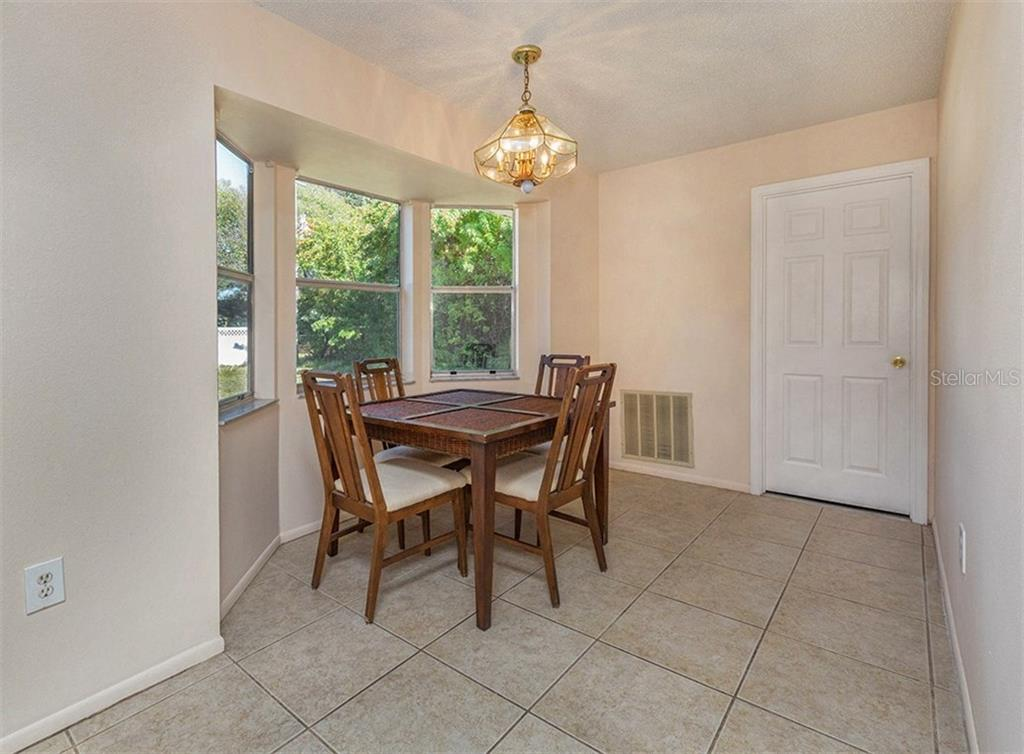 Dining Room - Single Family Home for sale at 10308 Grail Ave, Englewood, FL 34224 - MLS Number is N5911429