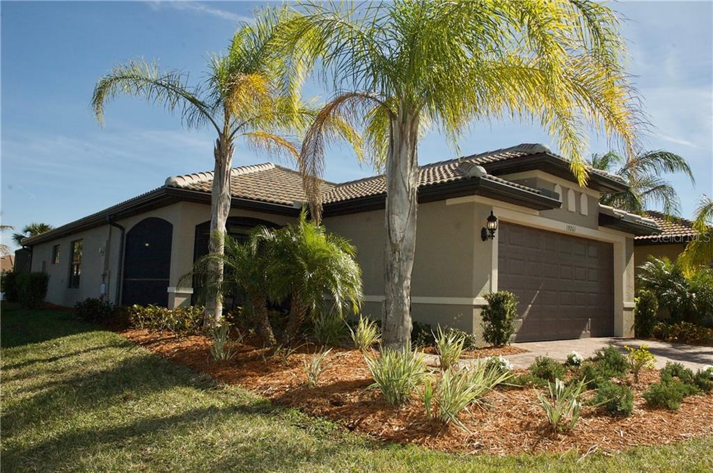 be greeted by long lake views every time you enter your new home - Single Family Home for sale at 19261 Isadora St, Venice, FL 34293 - MLS Number is N5911485