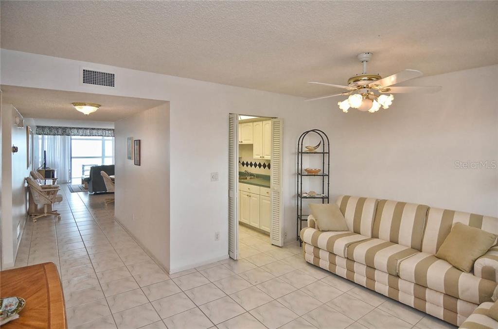 Den to dining/living room and kitchen. - Condo for sale at 255 The Esplanade N #805, Venice, FL 34285 - MLS Number is N5912261