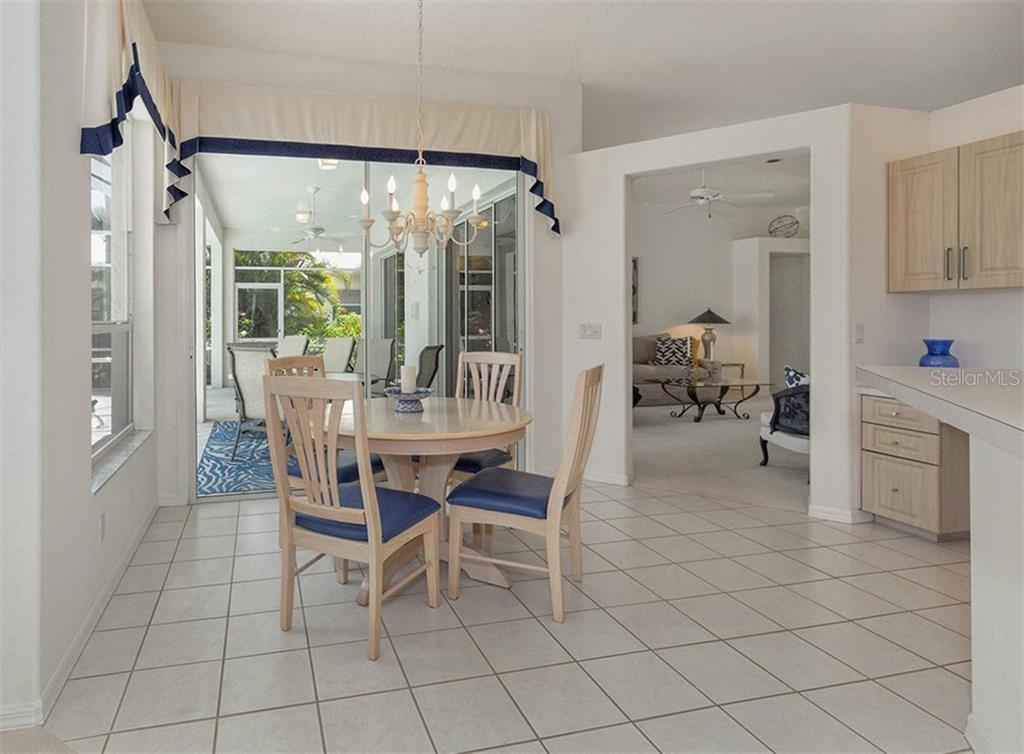 Dinette Opens To The Lanai - Single Family Home for sale at 122 Ventana Way, Venice, FL 34292 - MLS Number is N5912714