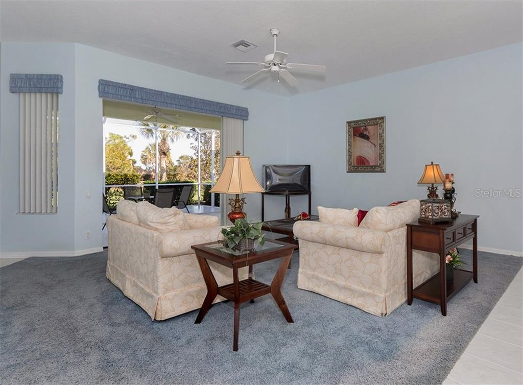 Living room/entry - Single Family Home for sale at 2122 Timucua Trl, Nokomis, FL 34275 - MLS Number is N5913111
