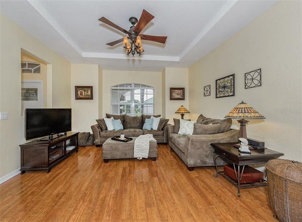 Living room - Single Family Home for sale at 11759 Puma Path, Venice, FL 34292 - MLS Number is N5913611