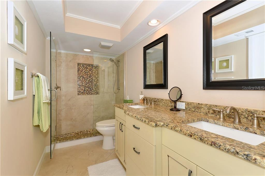 Breakfast bar, coffered ceiling, wood-look tile flooring, bead-board under breakfast bar and a view of the Gulf of Mexico - Single Family Home for sale at 255 The Esplanade N #706, Venice, FL 34285 - MLS Number is N5913875