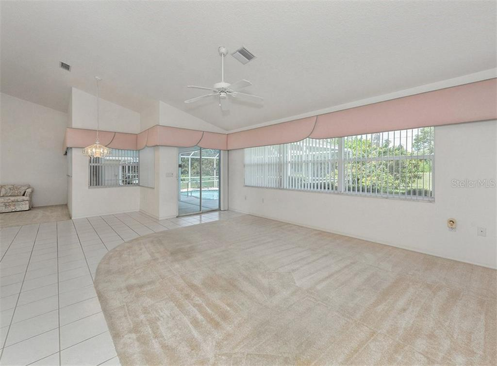 Family room to lanai/pool - Single Family Home for sale at 683 May Apple Way, Venice, FL 34293 - MLS Number is N5913909