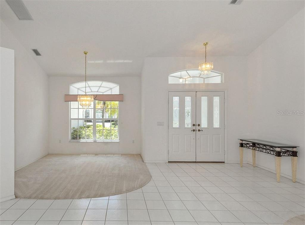 Foyer/dining room - Single Family Home for sale at 683 May Apple Way, Venice, FL 34293 - MLS Number is N5913909