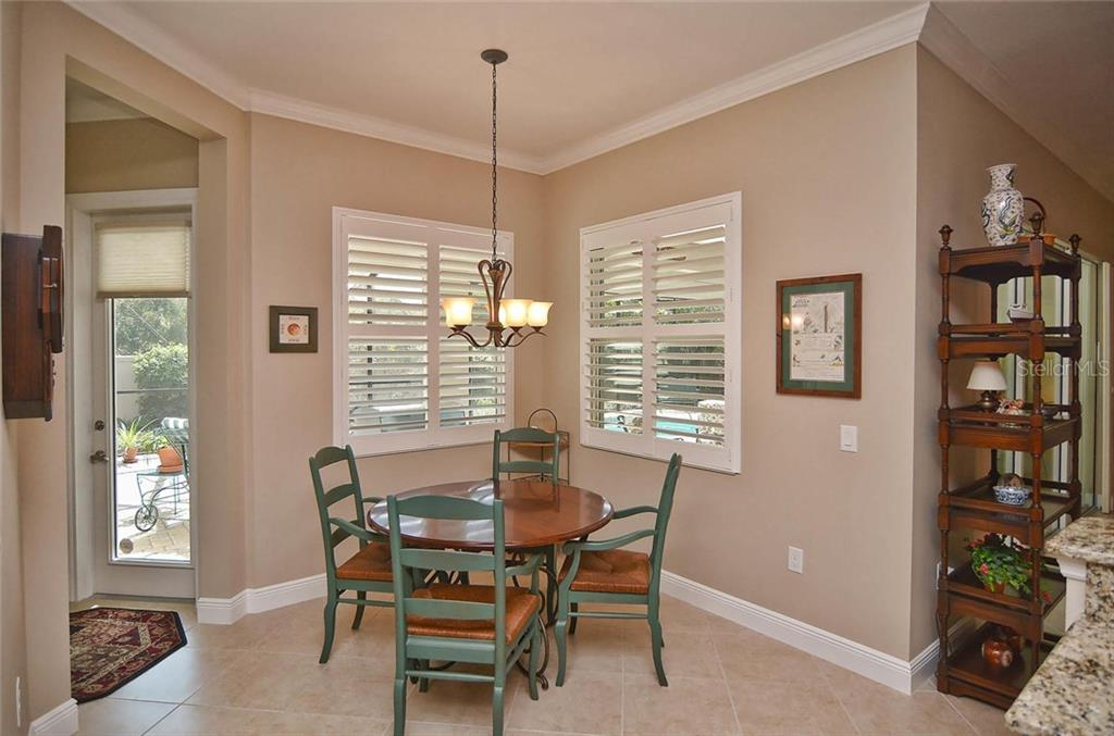 Breakfast nook - Single Family Home for sale at 293 Marsh Creek Rd, Venice, FL 34292 - MLS Number is N5914238