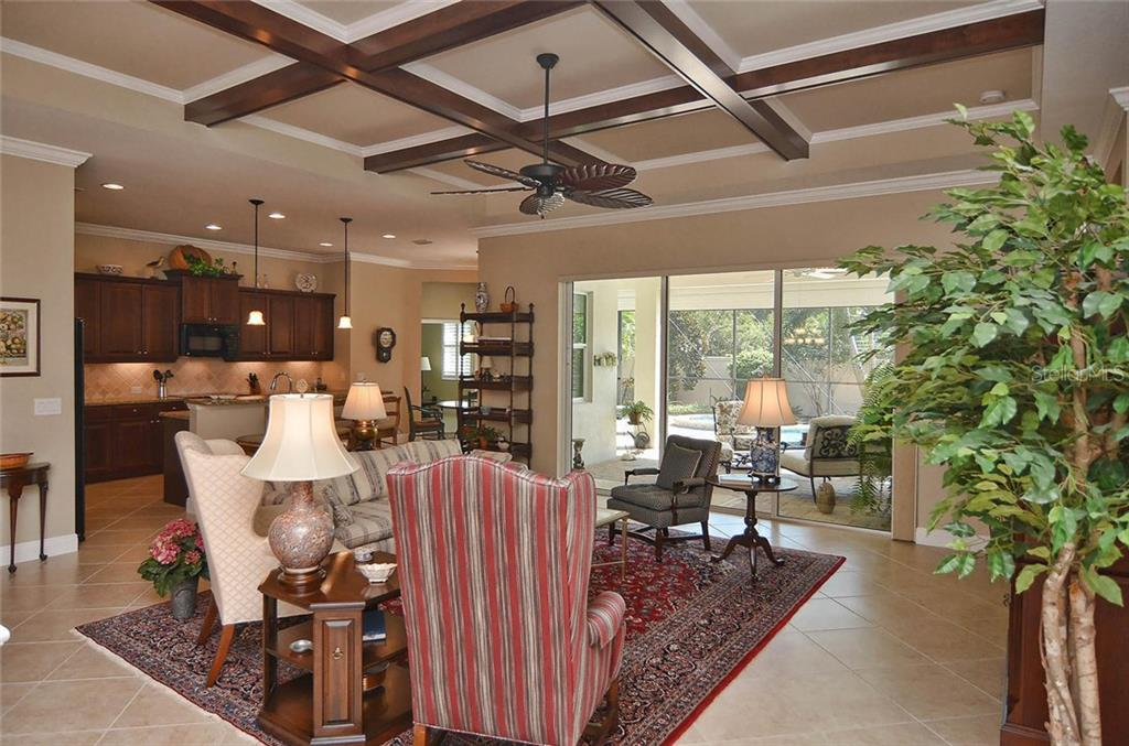 Great room to lanai and kitchen - Single Family Home for sale at 293 Marsh Creek Rd, Venice, FL 34292 - MLS Number is N5914238