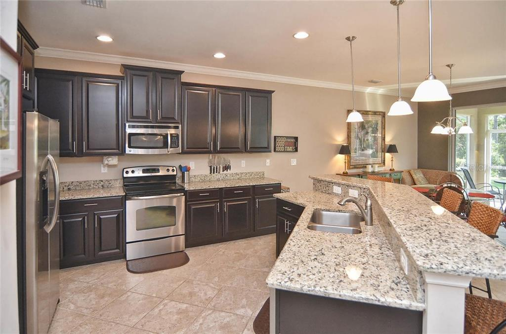 Kitchen - Single Family Home for sale at 9124 Coachman Dr, Venice, FL 34293 - MLS Number is N5914408