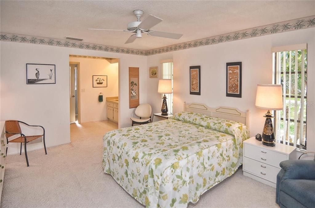 Master bedroom to master bath - Single Family Home for sale at 1410 Strada D Argento, Venice, FL 34292 - MLS Number is N5914540