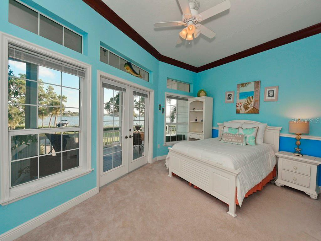 Bedroom 2 Suite with stunning bay views and private full bath. - Single Family Home for sale at 200 Sunrise Dr, Nokomis, FL 34275 - MLS Number is N5914820