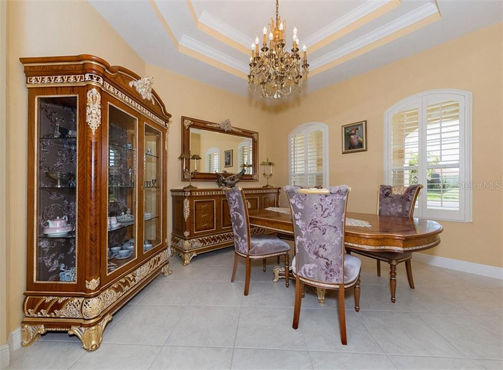 Dining room - Single Family Home for sale at 221 Portofino Dr, North Venice, FL 34275 - MLS Number is N5914925