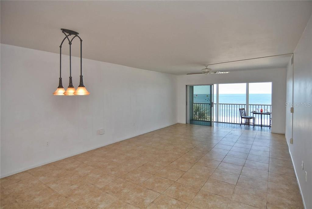 Dining/living room with sliders to lanai with view of the Gulf - Condo for sale at 333 The Esplanade N #402, Venice, FL 34285 - MLS Number is N5914981