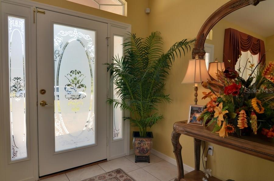 Etched entry door and side panels... - Single Family Home for sale at 4265 Irdell Ter, North Port, FL 34288 - MLS Number is N5915255