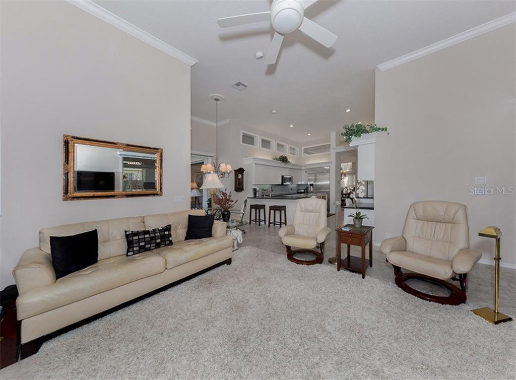 Family Room And Kitchen - Single Family Home for sale at 329 Venice Golf Club Dr, Venice, FL 34292 - MLS Number is N5915275