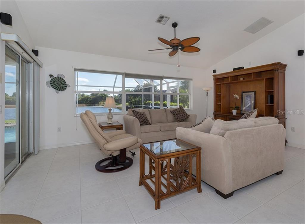 Family room - Single Family Home for sale at 866 Wood Sorrel Ln, Venice, FL 34293 - MLS Number is N5915362