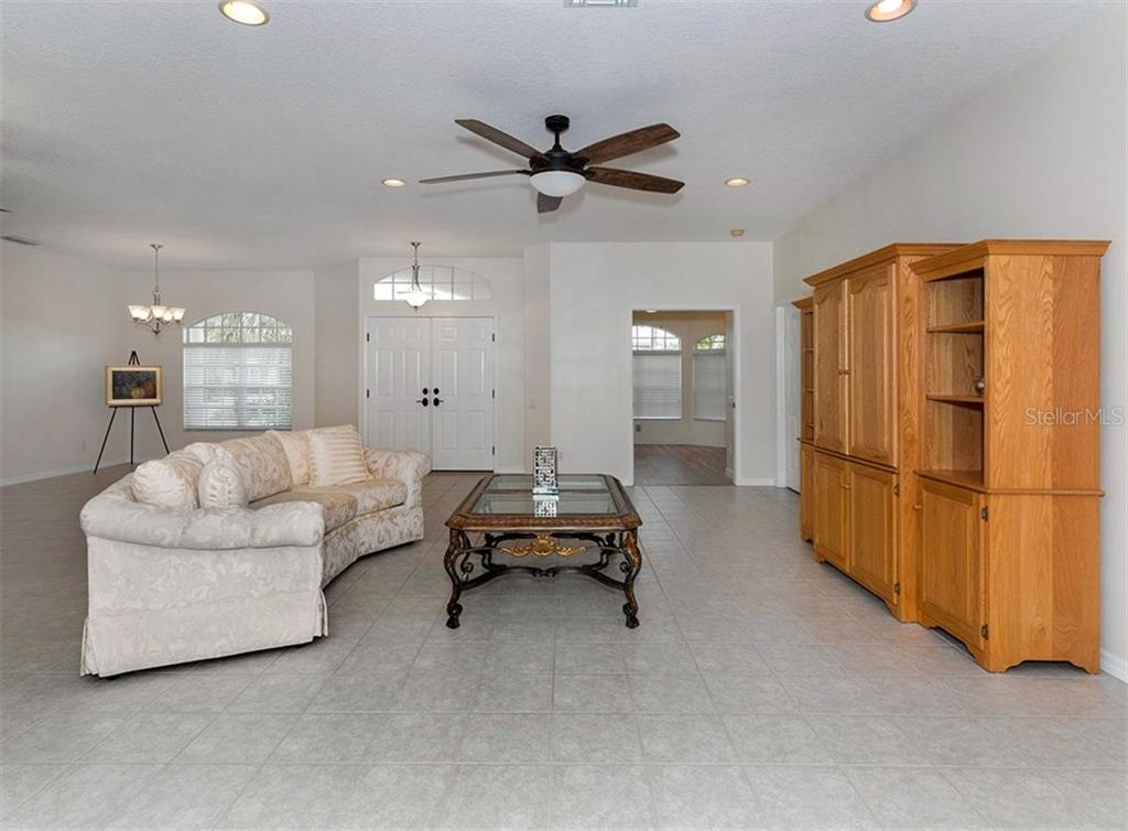 Living room, dining room, entry, bedroom - Single Family Home for sale at 2196 Calusa Lakes Blvd, Nokomis, FL 34275 - MLS Number is N5915879