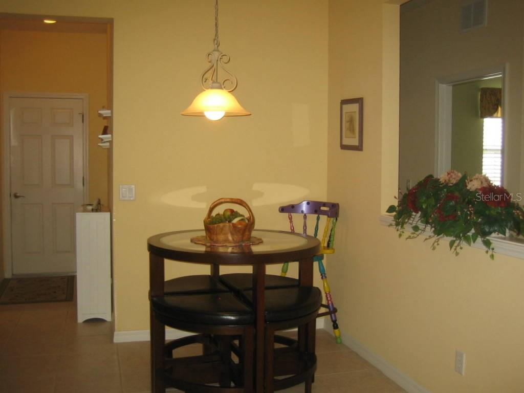 Eat in area in kitchen - Villa for sale at 1445 Maseno Dr, Venice, FL 34292 - MLS Number is N5916837