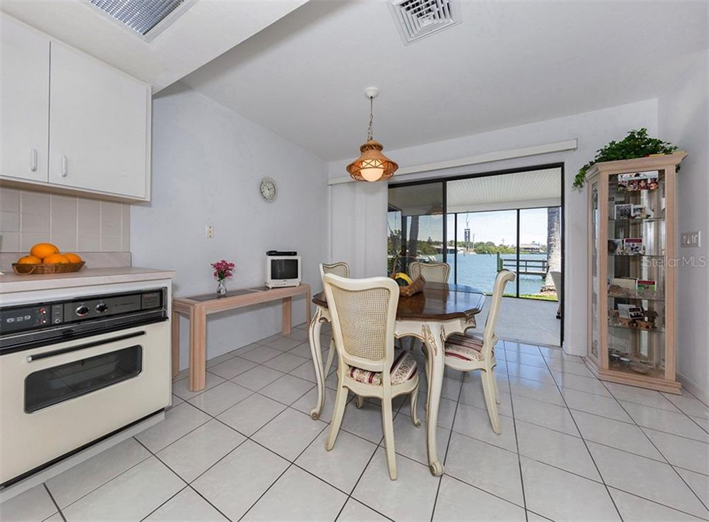 Kitchen/Dining Area - Single Family Home for sale at 199 Bayview Pkwy, Nokomis, FL 34275 - MLS Number is N6100311