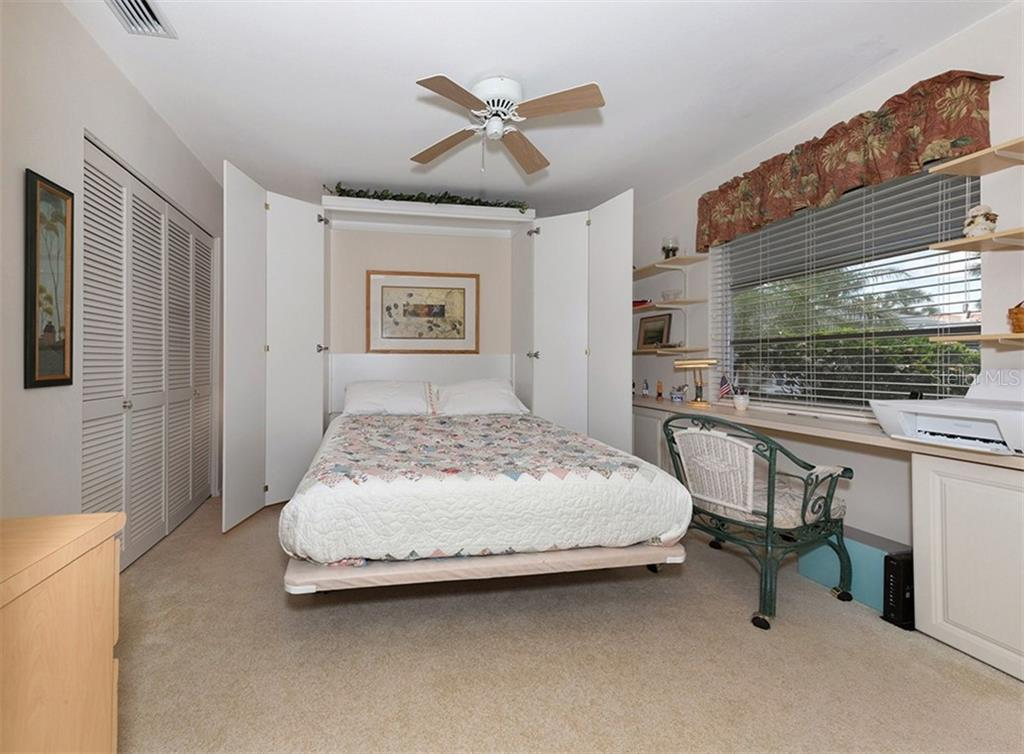 Bedroom 2 with murphy bed open. - Condo for sale at 100 The Esplanade N #4, Venice, FL 34285 - MLS Number is N6100334