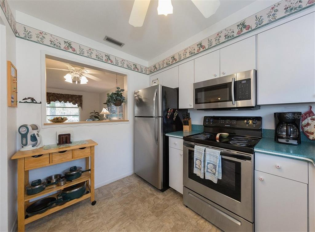 Kitchen features large pass through window to living/dining area. - Condo for sale at 100 The Esplanade N #4, Venice, FL 34285 - MLS Number is N6100334