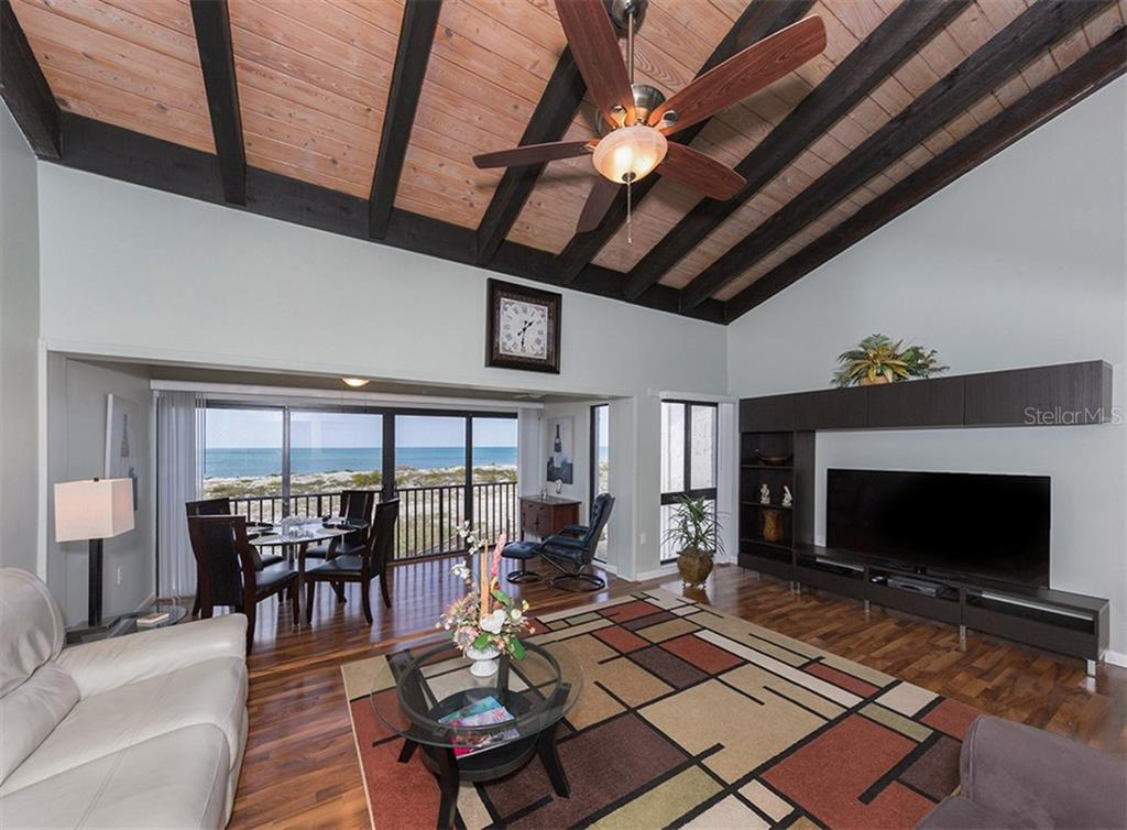 A sweeping view of the Gulf of Mexico frames this open living and dining area. - Condo for sale at 500 Park Blvd S #67, Venice, FL 34285 - MLS Number is N6100360