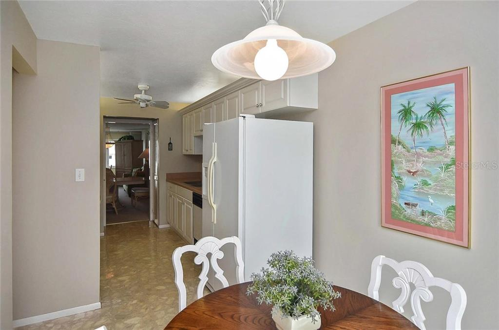 Dinette to kitchen - Condo for sale at 500 The Esplanade N #402, Venice, FL 34285 - MLS Number is N6100557