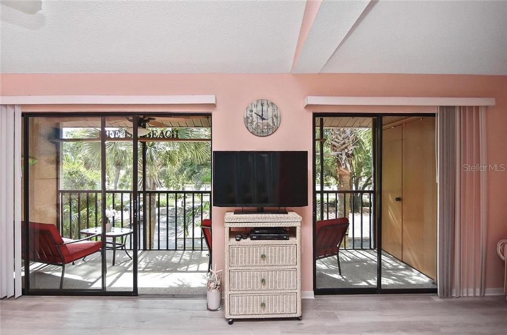 Sliders to lanai - Condo for sale at 654 Bird Bay Dr E #201, Venice, FL 34285 - MLS Number is N6101101