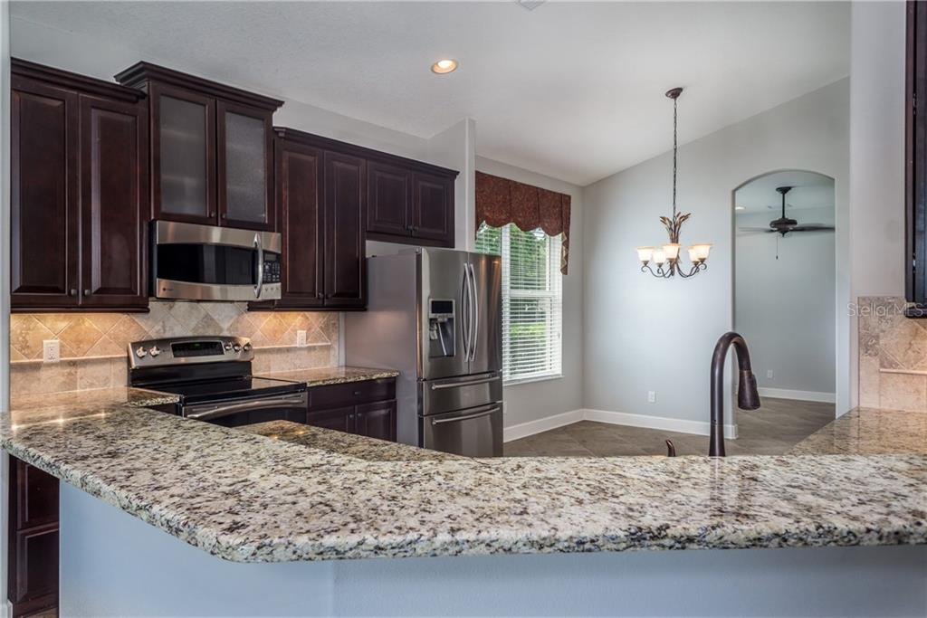 Wood Cabinetry and Volume Ceilings - Single Family Home for sale at 2290 Terracina Dr, Venice, FL 34292 - MLS Number is N6101301