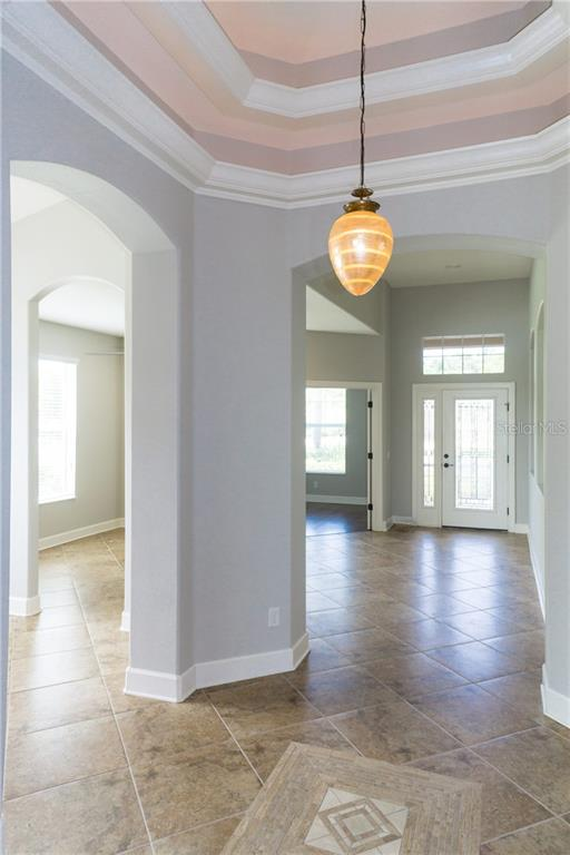 Foyer with Trey Ceilings & Crown Molding - Single Family Home for sale at 2290 Terracina Dr, Venice, FL 34292 - MLS Number is N6101301