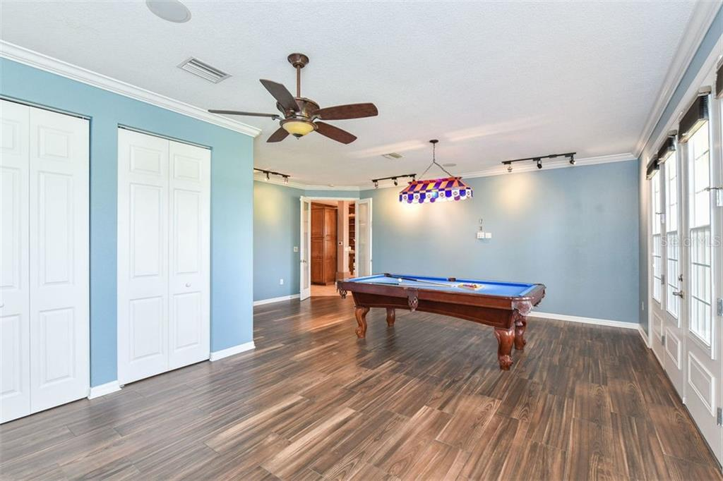 Game room - Single Family Home for sale at 9150 Deer Ct, Venice, FL 34293 - MLS Number is N6101408