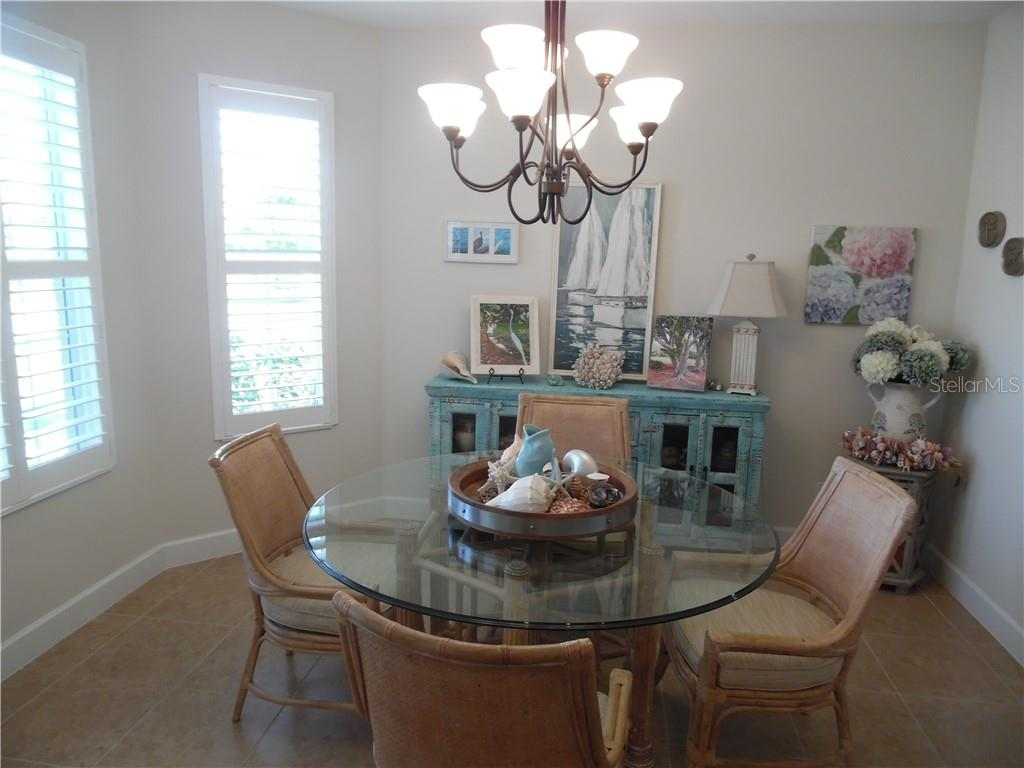 dining room measures 11'x13' - Single Family Home for sale at 239 Nolen Dr, Venice, FL 34292 - MLS Number is N6101457