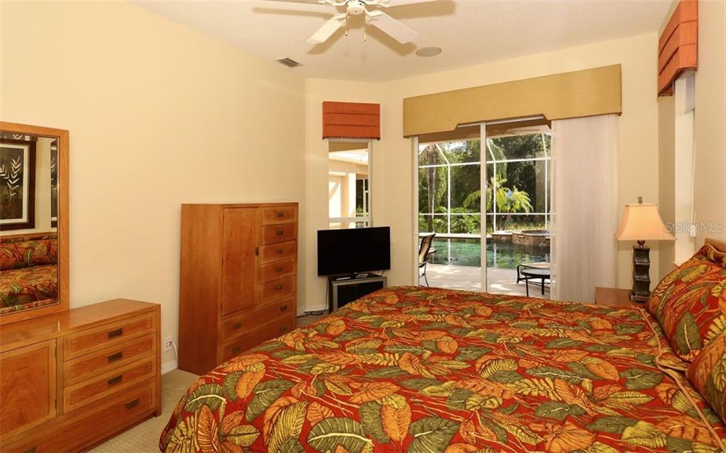 Master bedroom with view of pool - Single Family Home for sale at 913 Chickadee Dr, Venice, FL 34285 - MLS Number is N6101770