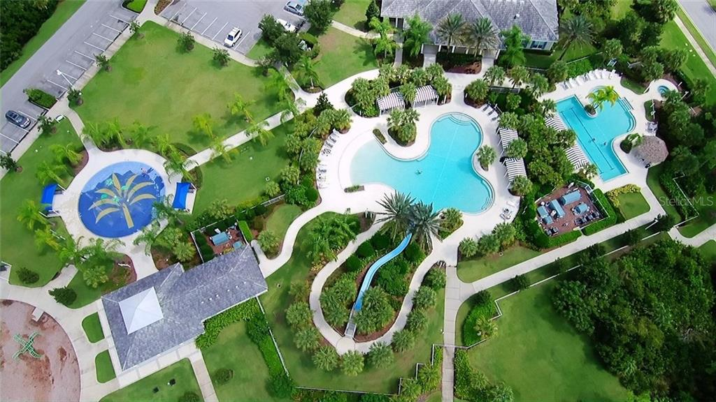Aerial of community pool and clubhouse - Single Family Home for sale at 21220 St Petersburg Dr, Venice, FL 34293 - MLS Number is N6101838