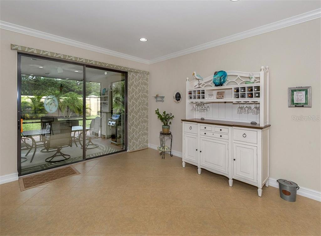 Great room with slider to lanai - Single Family Home for sale at 646 Resolute St, Nokomis, FL 34275 - MLS Number is N6102035