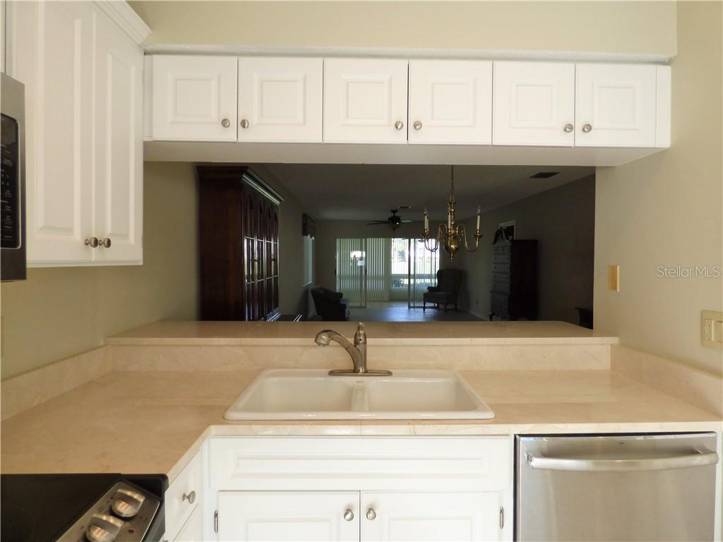 Light and bright kitchen with the pass thru to maintain an open flow into the dining and living rooms. - Villa for sale at 206 Cerromar Way S #25, Venice, FL 34293 - MLS Number is N6102127