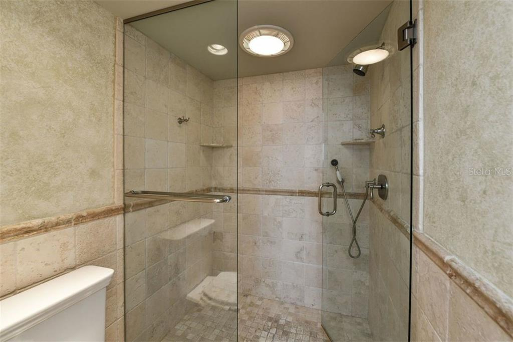 MASTER SHOWER WITH HAND HELD AND REGULAR SHOWER HEAD - Condo for sale at 5740 Midnight Pass Rd #505 F, Sarasota, FL 34242 - MLS Number is N6102195