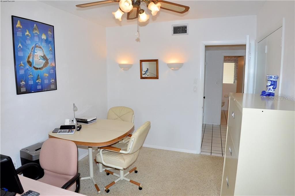 Guest bedroom 2 office suite - Single Family Home for sale at 609 Armada Rd N, Venice, FL 34285 - MLS Number is N6102952