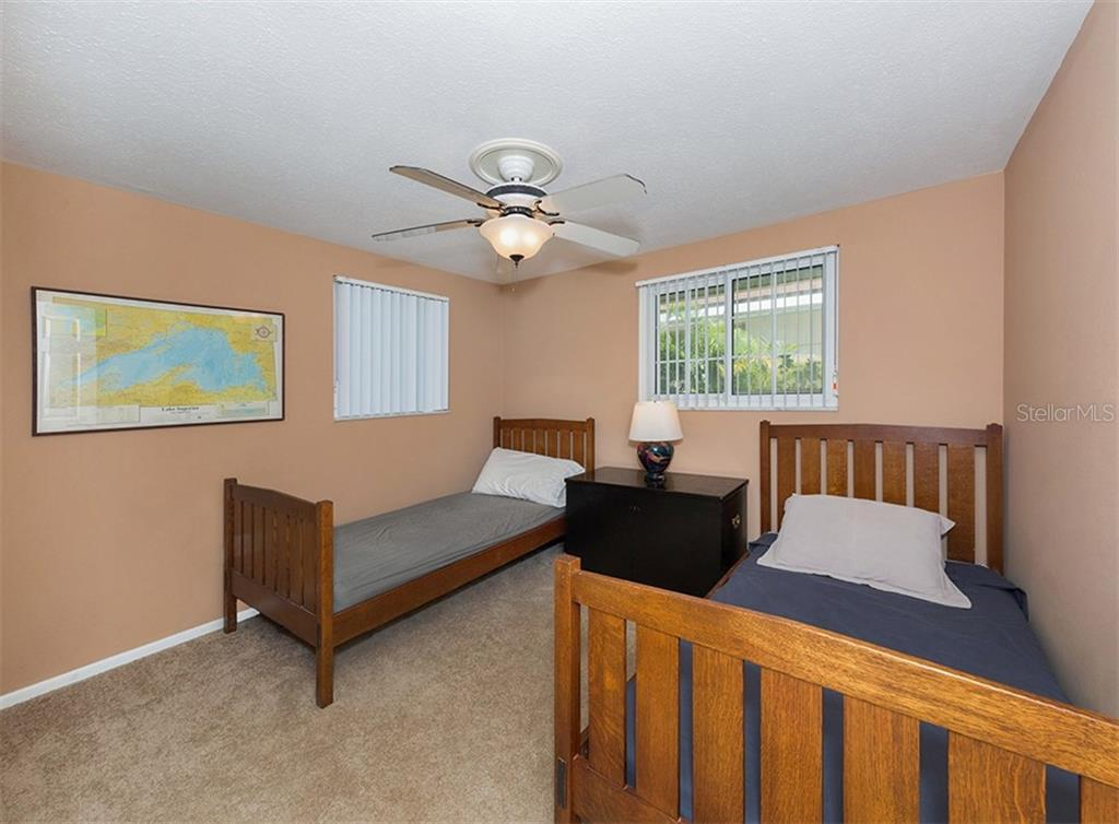 Bedroom 2 - Single Family Home for sale at 717 Guild Dr, Venice, FL 34285 - MLS Number is N6103134