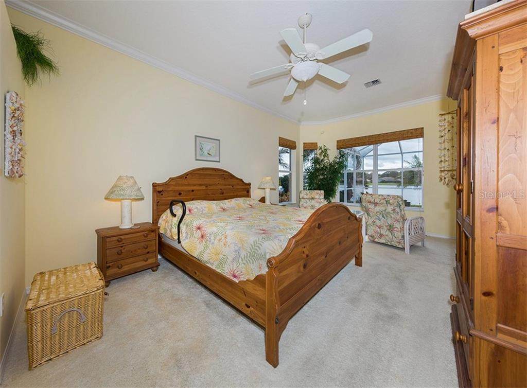 Master bedroom with lake view - Single Family Home for sale at 627 Lakescene Dr, Venice, FL 34293 - MLS Number is N6103268