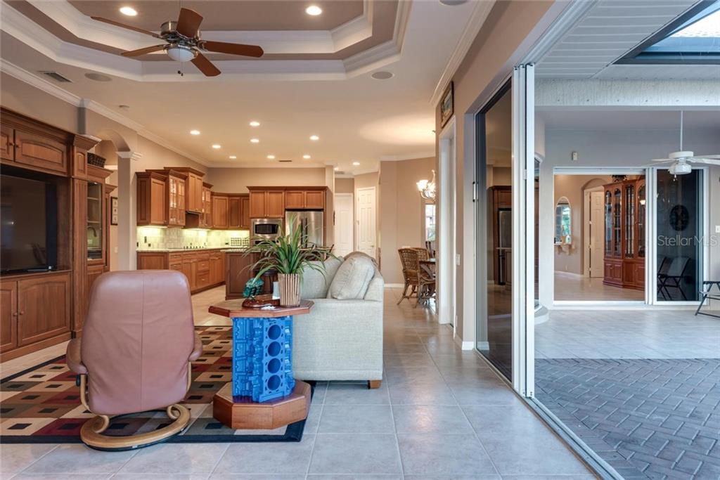 Family room to kitchen and lanai - Single Family Home for sale at 821 Adonis Pl, Venice, FL 34292 - MLS Number is N6104303