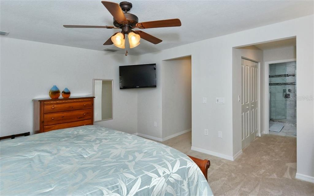 Master bedroom to master bath - Single Family Home for sale at 1460 Strada D Argento, Venice, FL 34292 - MLS Number is N6104612