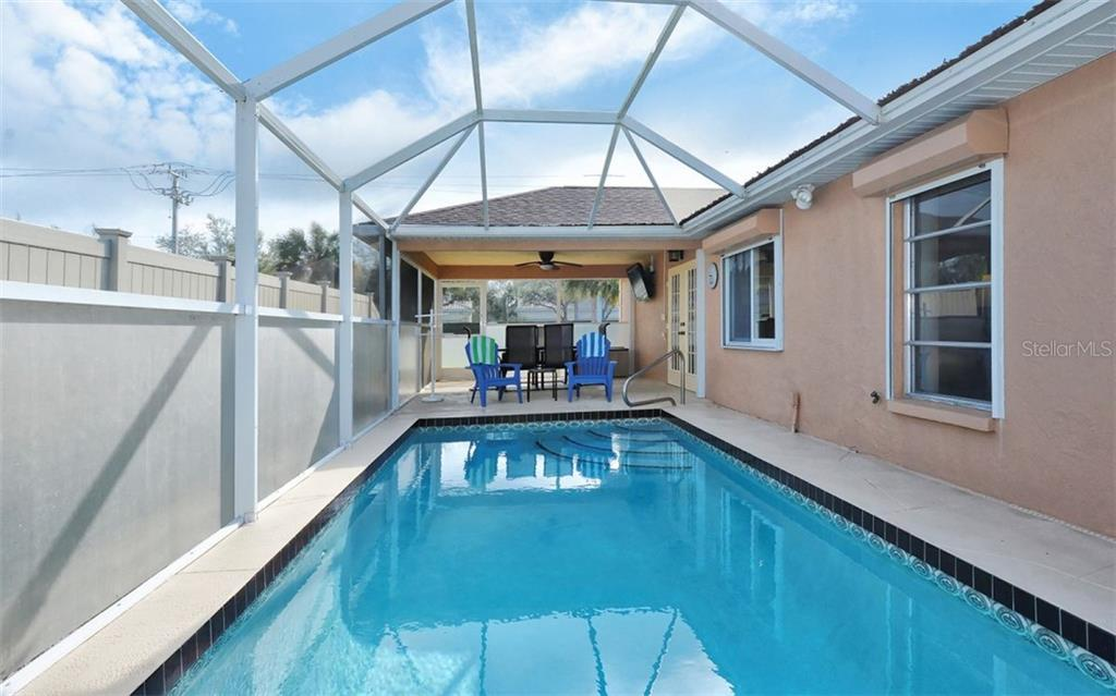 Pool to lanai - Single Family Home for sale at 1460 Strada D Argento, Venice, FL 34292 - MLS Number is N6104612