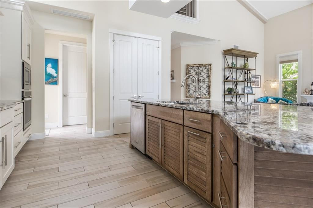 Kitchen has closet pantry in addition to ample amount of cabinetry space. - Single Family Home for sale at 1716 Arlington St, Sarasota, FL 34239 - MLS Number is N6104891