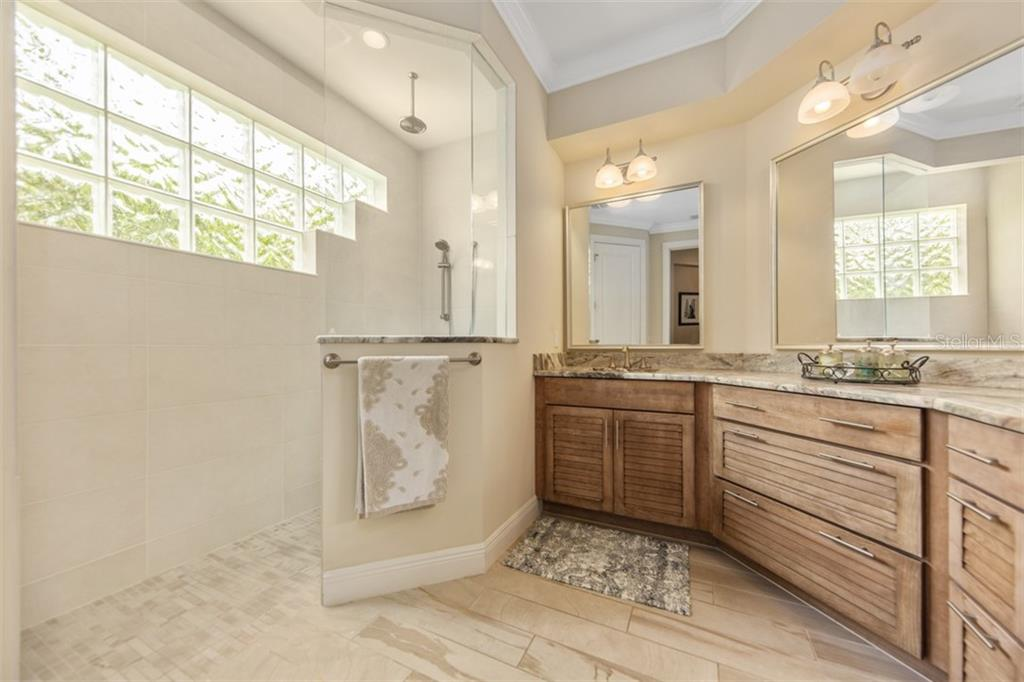 En Suite has granite counter top, dual sinks and walk in shower - Single Family Home for sale at 1716 Arlington St, Sarasota, FL 34239 - MLS Number is N6104891