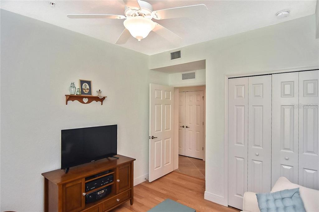 Solid wood red oak flooring in the guest room. - Condo for sale at 20111 Ragazza Cir #102, Venice, FL 34293 - MLS Number is N6105517