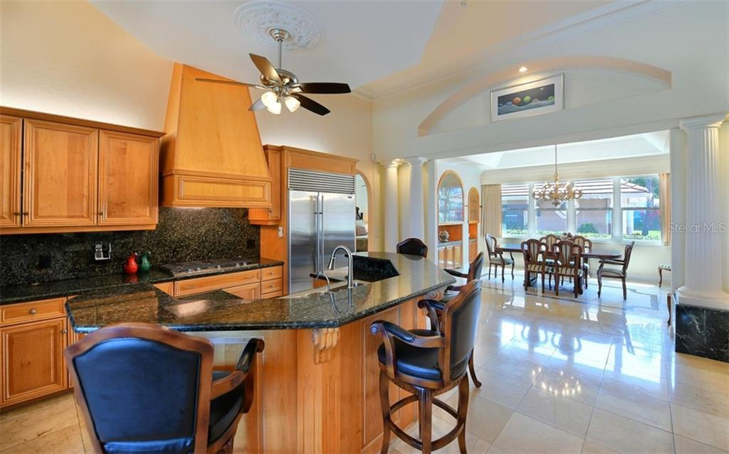 Breakfast bar, kitchen to dining room - Single Family Home for sale at 412 Hunter Dr, Venice, FL 34285 - MLS Number is N6105563