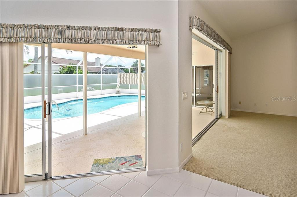 Dinette with slider to pool - Single Family Home for sale at 2232 E Village Cir, Venice, FL 34293 - MLS Number is N6105697